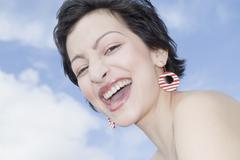 Hispanic woman wearing funky earrings Stock Photos