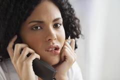 African businesswoman talking on telephone Stock Photos