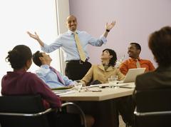 Multi-ethnic businesspeople having meeting Stock Photos