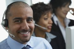 Middle Eastern businessman wearing headset - stock photo