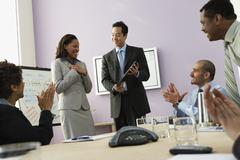 Businesswoman receiving plaque - stock photo