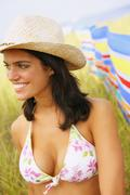 Woman wearing bikini top and straw hat Stock Photos