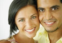 Close up of couple smiling - stock photo