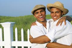 Stock Photo of Hispanic twin brothers hugging