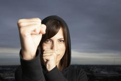 Hispanic woman in fighting stance - stock photo