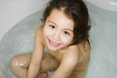 Asian girl in bath tub - stock photo
