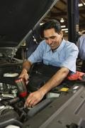 Indian male auto mechanic in shop Stock Photos