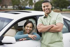 African teenager in car with father Stock Photos