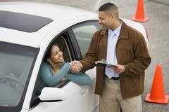 African teenager shaking hands with driving instructor Stock Photos