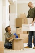 African couple unpacking in new house Stock Photos