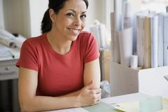 Hispanic female architect at desk - stock photo