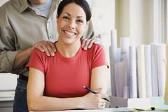 Hispanic female architect at desk Stock Photos