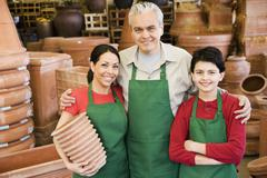 Hispanic family working at garden center - stock photo