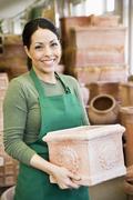 Hispanic woman working at garden center - stock photo
