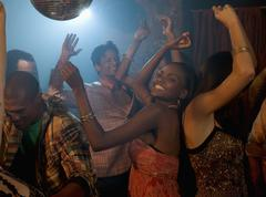 Multi-ethnic friends dancing at nightclub - stock photo