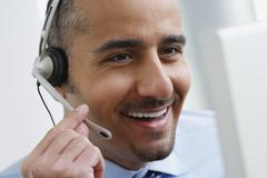 Middle Eastern businessman wearing headset Stock Photos