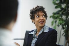 African businesswoman looking to side Stock Photos