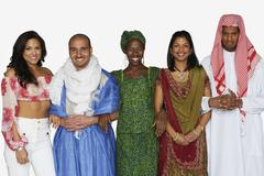 Multi-ethnic people in traditional dress - stock photo
