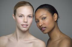 Multi-ethnic women with bare shoulders Stock Photos