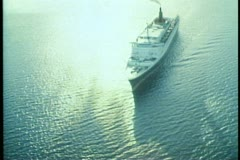 Queen Elizabeth 2, aerial, wide shot, backlighting, sailing over The Pacific Stock Footage