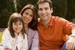 Portrait of Hispanic family outdoors - stock photo