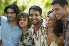 South American friends hugging - stock photo