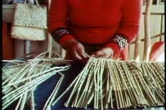 Maori woman working on making grass skirts, close up, tilt up Stock Footage