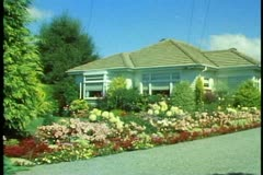 Gardens of Christchurch, New Zealand, private house, medium shot, pan right Stock Footage