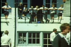 Christ College, Christchurch, New Zealand, students in building standing on rail Stock Footage