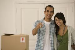 Young couple holding new house keys Stock Photos