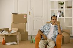 Young man sitting in new house Stock Photos