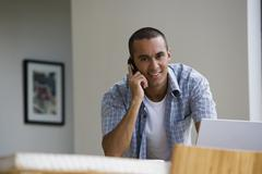 Young man talking on telephone Stock Photos