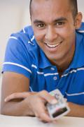 Young man pointing remote control Stock Photos