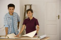 Asian couple hanging wall paper Stock Photos