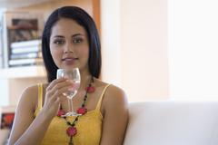 Young woman drinking wine Stock Photos
