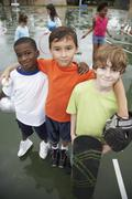 Multi-ethnic boys with sports gear Stock Photos