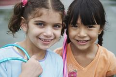 Close up of multi-ethnic girls smiling Stock Photos