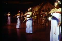 Maori dances, traditional, swinging pom poms, wide shot Stock Footage