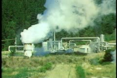 Geothermal power plant, New Zealand South Island, conduit pipes, steam rising - stock footage