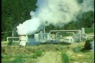 Geothermal power plant, New Zealand South Island, conduit pipes, steam rising Stock Footage