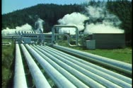 Stock Video Footage of Geothermal power plant, New Zealand South Island, conduit pipes, steam rising