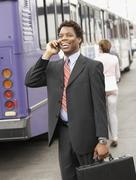 African American businessman talking on cell phone Stock Photos