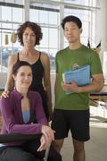Multi-ethnic business owners in exercise studio Stock Photos