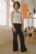 Senior woman in exercise studio Stock Photos