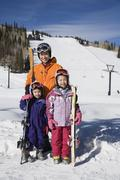 Asian mother and daughters in ski gear Stock Photos