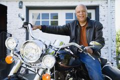 Senior African American man sitting on motorcycle - stock photo