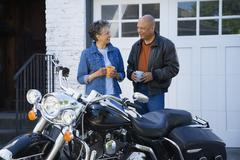 Senior African American couple next to motorcycle - stock photo