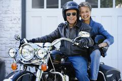 Senior African American couple on motorcycle - stock photo