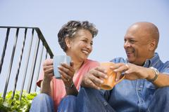 Senior African American couple drinking coffee - stock photo