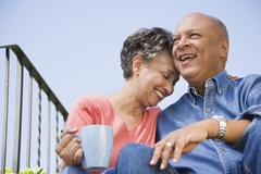Senior African American couple hugging - stock photo